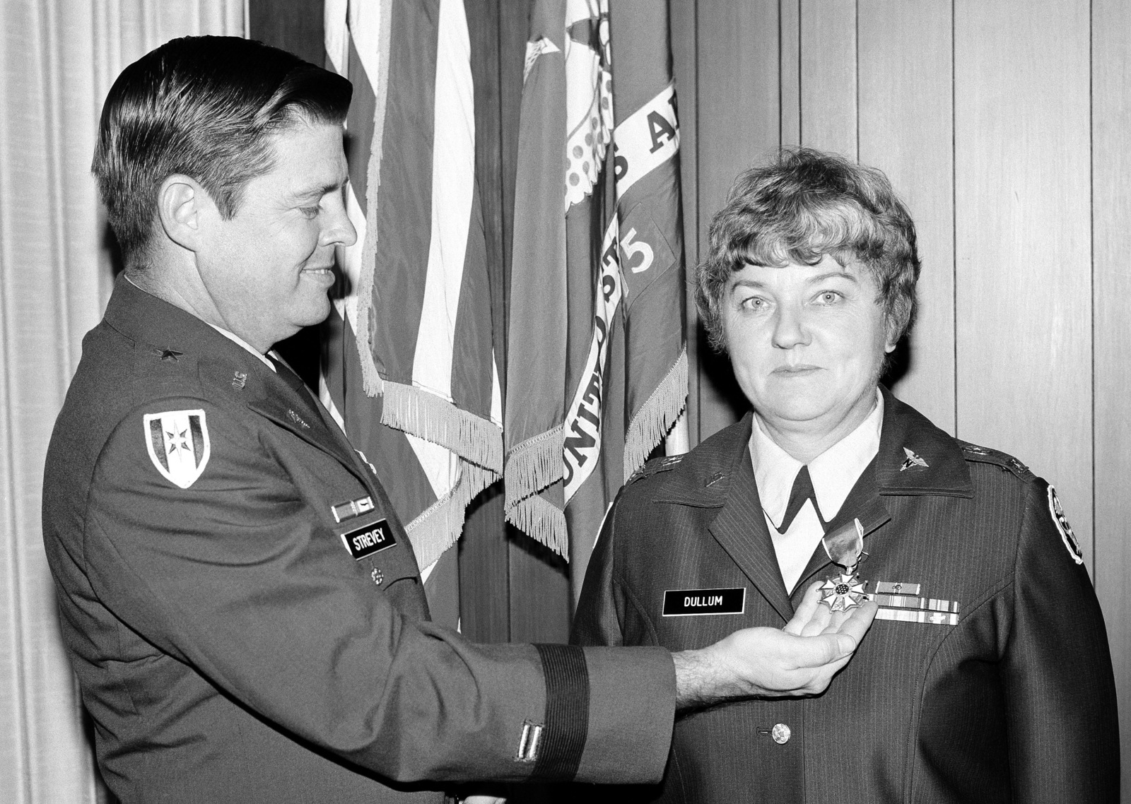 The Legion of Merit is presented to COL Marlys E. Dullum, assistant chief, Department of Nursing, Brooke Army Medical Center, by BGEN Tracy E. Strevey Jr., BAMC commander