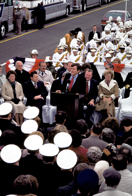 The audience and distinguished guests on the speaker's platform listen as Secretary of the Navy John F. Lehman Jr. speaks at the keel laying of the nuclear-powered aircraft carrier THEODORE ROOSEVELT (CVN-71). Secretary of Defense Caspar Weinberger and Mrs. Weinberger are seated on the platform in the front row to the right of Lehman. Mrs. Weinberger is the ship's sponsor