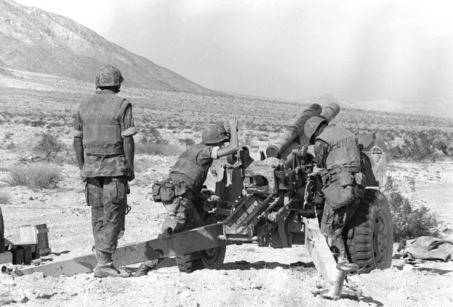 A 105mm howitzer crew from Charlie Company, 1ST Battalion, 10th Marines, prepare for a fire mission. The company is participating in Operation CAX-1-2-82
