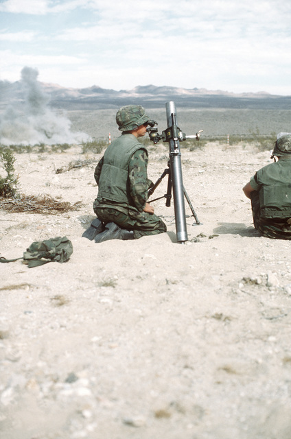 A combat-ready Marine, LCPL Smith, checks the sight on an M-29 81mm mortar prior to the next fire mission during Operation CAX 1-2-82 at the Marine Corps Air-to-Ground Combat Center