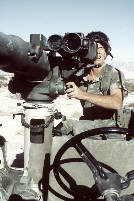 A combat-ready Marine, LCPL Williams, checks the scope of the M-151 jeep-mounted heavy anti-tank weapon (TOW) during Operation CAX 1-2-82 at the Marine Corps Air-to-Ground Combat Center