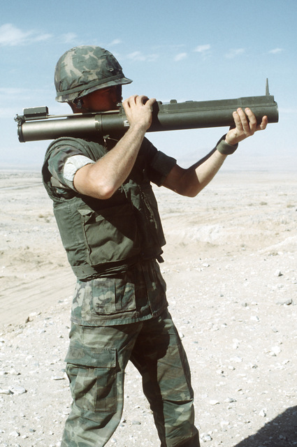 A combat-ready Marine, PFC Williams, prepares to fire the light anti-armor weapon (LAW) during Operation CAX 1-2-82 at the Marine Corps Air-to-Ground Combat Center