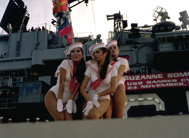 A dance group entertains the crew aboard the aircraft