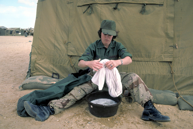 A female airman first class does her laundry during exercise Bright Star '82