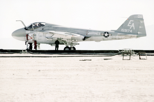 A Marine A-6A Intruder aircraft is given the final check by a lineman and the crew chief prior to take-off during Operation CAX 1-2-82 at the Marine Corps Air-to-Ground Combat Center