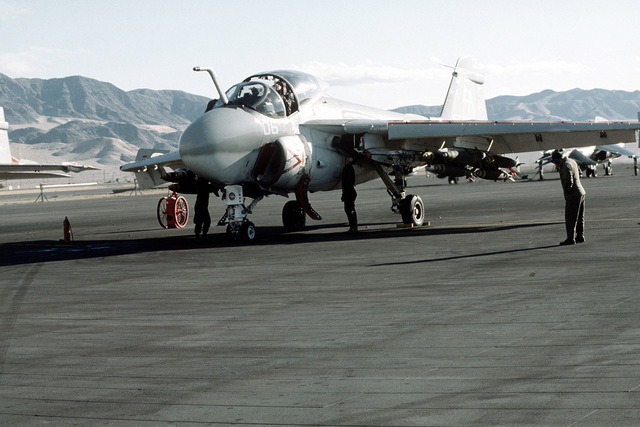 A Marine A-6A Intruder aircraft loaded with bombs, is given a last minute check prior to take-off. This is part of Operation CAX 1-2-82, held at the Marine Corps Air-to-Ground Combat Center