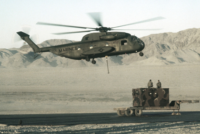A Marine CH-53 Sea Stallion helicopter prepares to pick up a huge crate of supplies for the resupply of Marines in the field. The resupply operation is a part of Operation CAX 1-2-82 at the Marine Corps Air-to-Ground Combat Center