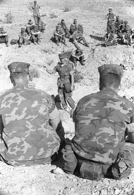 A Marine lieutenant colonel gives a briefing to members of one of his company during Operation CAX-1-2-82