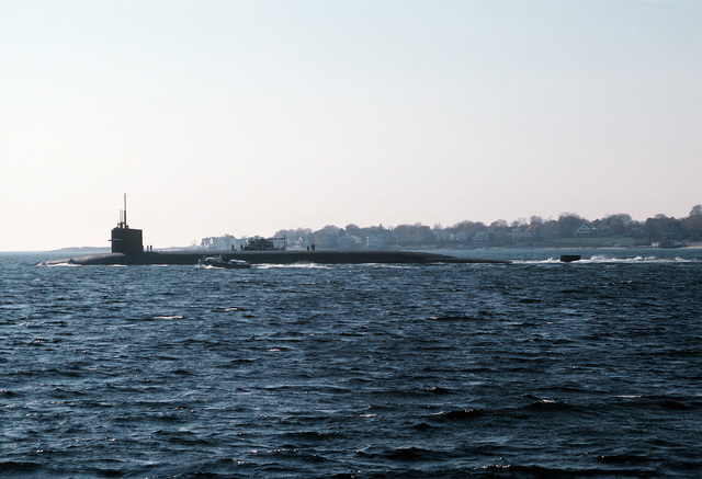A port quarter view of the nuclear-powered strategic missile submarine OHIO (SSBN-726) underway during final sea trials before commissioning. The submarine was built by General Dynamics