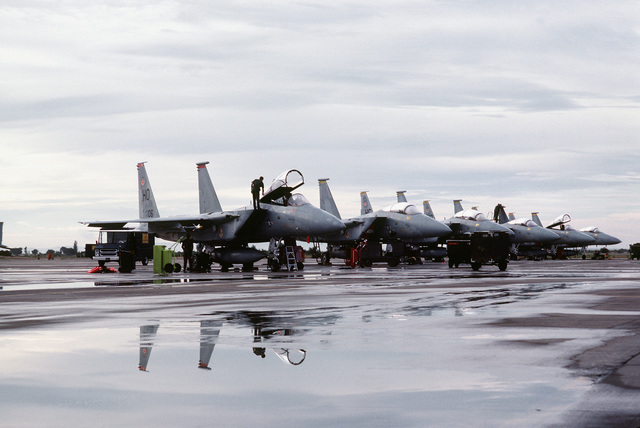 A right front view of F-15 Eagle aircraft assigned to the 7th and 8th Tactical Fighter Squadrons, 49th Tactical Fighter Wing, parked on the flight line