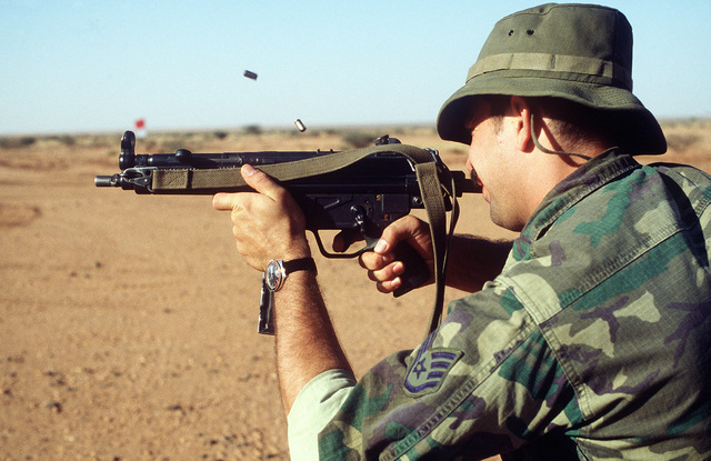 A U.S. Air Force SSGT fires a 9-mm MPS sub-machine gun at a firearms demonstration during exercise Bright Star '82