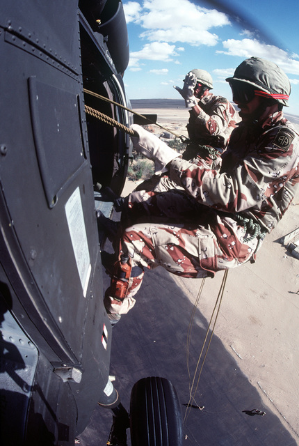 A U.S. troops rappel from a helicopter during exercise Bright Star '82