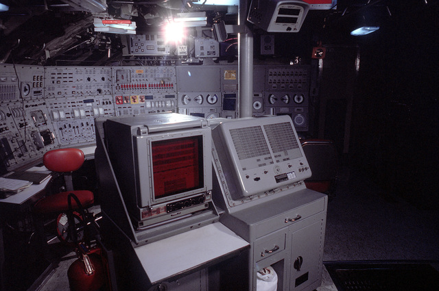 A view of the control room during a lull in precommissioning activities aboard the nuclear-powered ballistic missile submarine OHIO (SSBN-726). The submarine was built by General Dynamics Corp