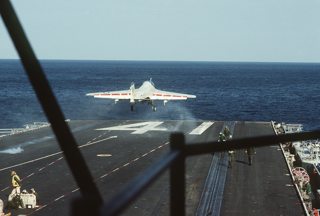 An A-6E Intruder aircraft is catapulted from the flight deck of the aircraft carrier USS MIDWAY (CV 41)