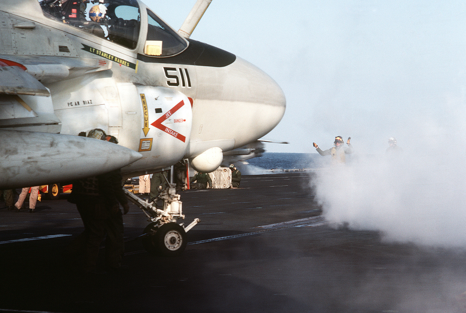 An A-6E Intruder aircraft is positioned on a catapult during flight operations aboard the aircraft carrier USS MIDWAY (CV 41)