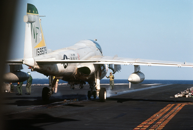 An A-6E Intruder aircraft is positioned on a catapult on the flight deck of the aircraft carrier USS MIDWAY (CV 41)