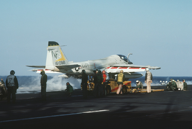 An A-6E Intruder aircraft prepares to be catapulted from the deck of the aircraft carrier USS MIDWAY (CV 41)