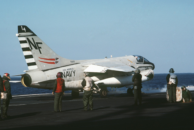 An A-7E Corsair II aircraft from Attack Squadron 93 prepares to be catapulted from the flight deck of the aircraft carrier USS MIDWAY (CV 41)