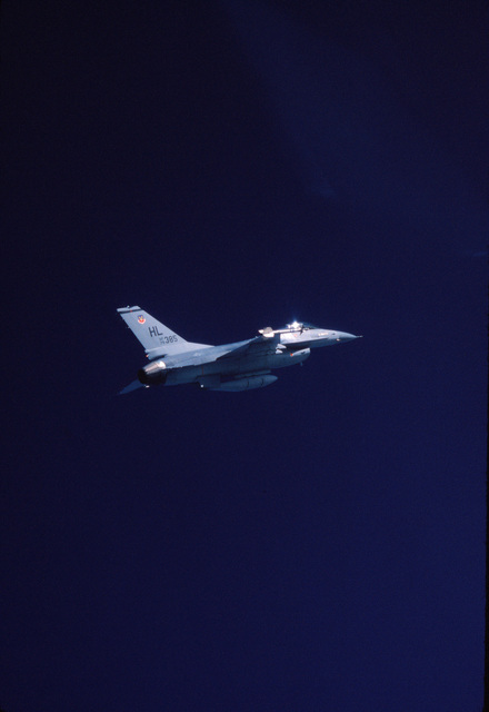 An air-to-air right underside view of an F-16 Falcon aircraft assigned to the 388th Tactical Fighter Wing during a mission out of Hill Air Force Base