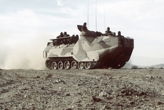 An AMTRAC (LVTP-7) that is used as a field mobile command center is moving very slowly as its crew communicates with other units. This is part of Operation CAX 1-2-82, held at the Marine Corps Air-to-Ground Combat Center