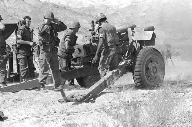 An artillery gun team from Charlie Battery, 5th Battalion, 10th Marines, reload their 105mm howitzer during Operation CAX-1-2-82