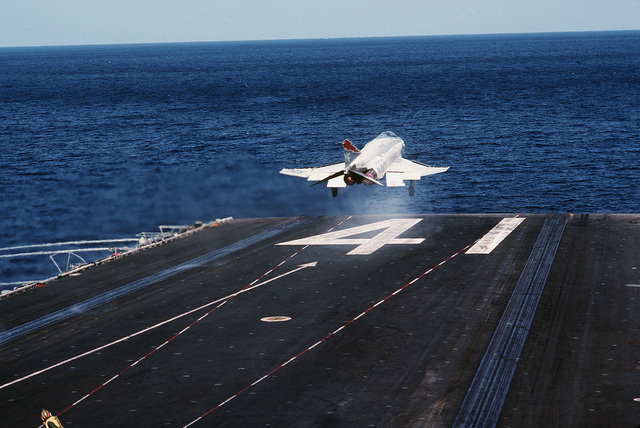 An F-4S Phantom II aircraft from Fighter Squadron 161 is catapulted from the flight deck of the aircraft carrier USS MIDWAY (CV 41)
