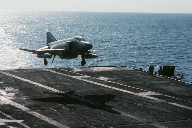 An F-4S Phantom II aircraft from Fighter Squadron 161 prepares to land aboard the aircraft carrier USS MIDWAY (CV 41)