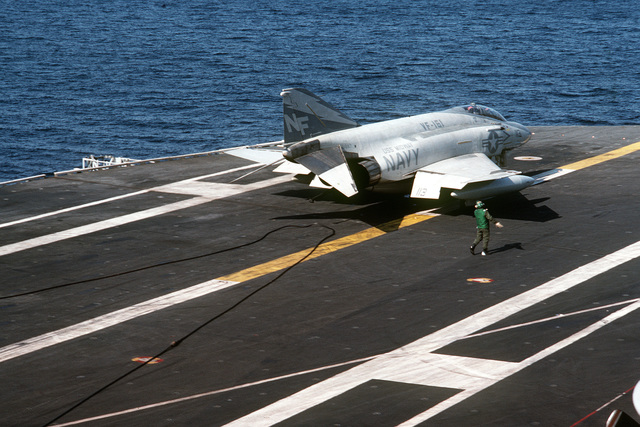 An F-4S Phantom II aircraft from Fighter Squadron 161 shortly after landing aboard the aircraft carrier USS MIDWAY (CV 41)