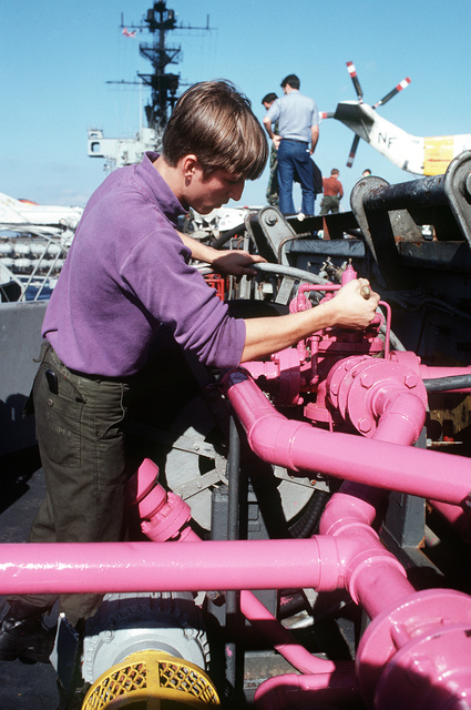 Aviation Boatswain's Mate F (Fuels) AIRMAN Apprentice Rick L. Slagle paints JP-4 fuel pipes aboard the aircraft carrier USS MIDWAY (CV 41)
