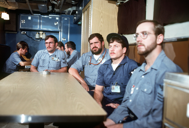 Crewmen watch television while sitting at a table in the crew lounge aboard the nuclear-powered fleet ballistic missile submarine OHIO (SSBN-726). The crewmen are assigned to precommissioning duty aboard the submarine built by General Dynamics Corp