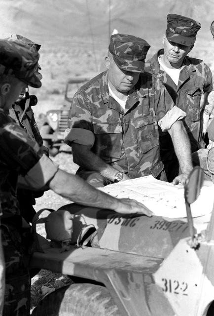 During Operation CAX-1-2-82, MGEN Alfred M. Gray Jr, commanding general, 2nd Marines Division, is briefed by the commanding officer of the 1ST Battalion, 8th Marines, on the present situation