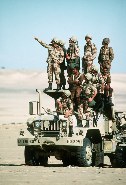 Egyptian and U.S. military observers watch a combined arms field exercise from a truck during Exercise Bright Star '82