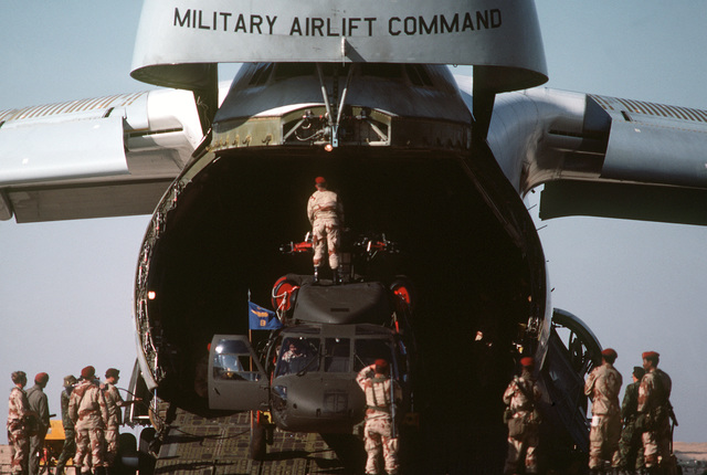 Egyptian and U.S. troops unload a CH-3 Jolly Green Giant helicopter from a C-5 Galaxy aircraft during Exercise Bright Star '82