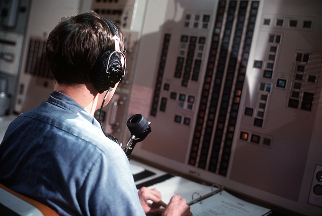 Fire Control Technician B 1ST Class (Submarines) (FTB1) (SS) David Starnes sits at a control room console and participates in a simulated missile firing during precommissioning activities aboard the nuclear-powered ballistic missile submarine OHIO (SSBN-726). The submarine, built by General Dynamics Corp., carries Trident C-4 (UGM-96) submarine-launched ballistic missiles (SLBM)