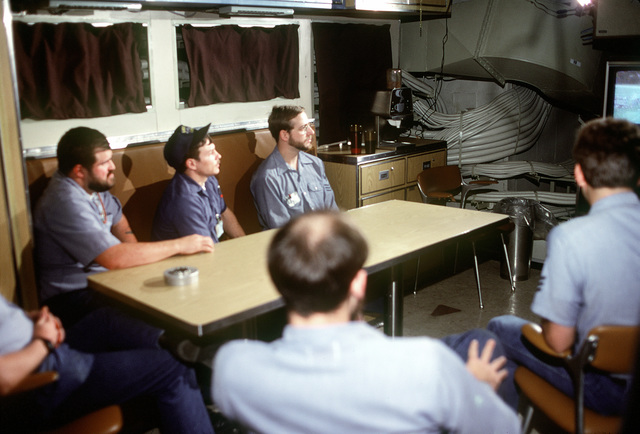 Five crewmen watch television in the crew lounge during precommissioning duty aboard the nuclear-powered ballistic missile submarine OHIO (SSBN-726). The men are, clockwise from right, IC1 (SS) D.M. Geske, MM2 (SS) P. A. Risley, TM1 (SS) Murphy, ST3 (SS) R. Antinson and EM1 (SS) P.W. Oakes. The submarine was built by General Dynamics Corp