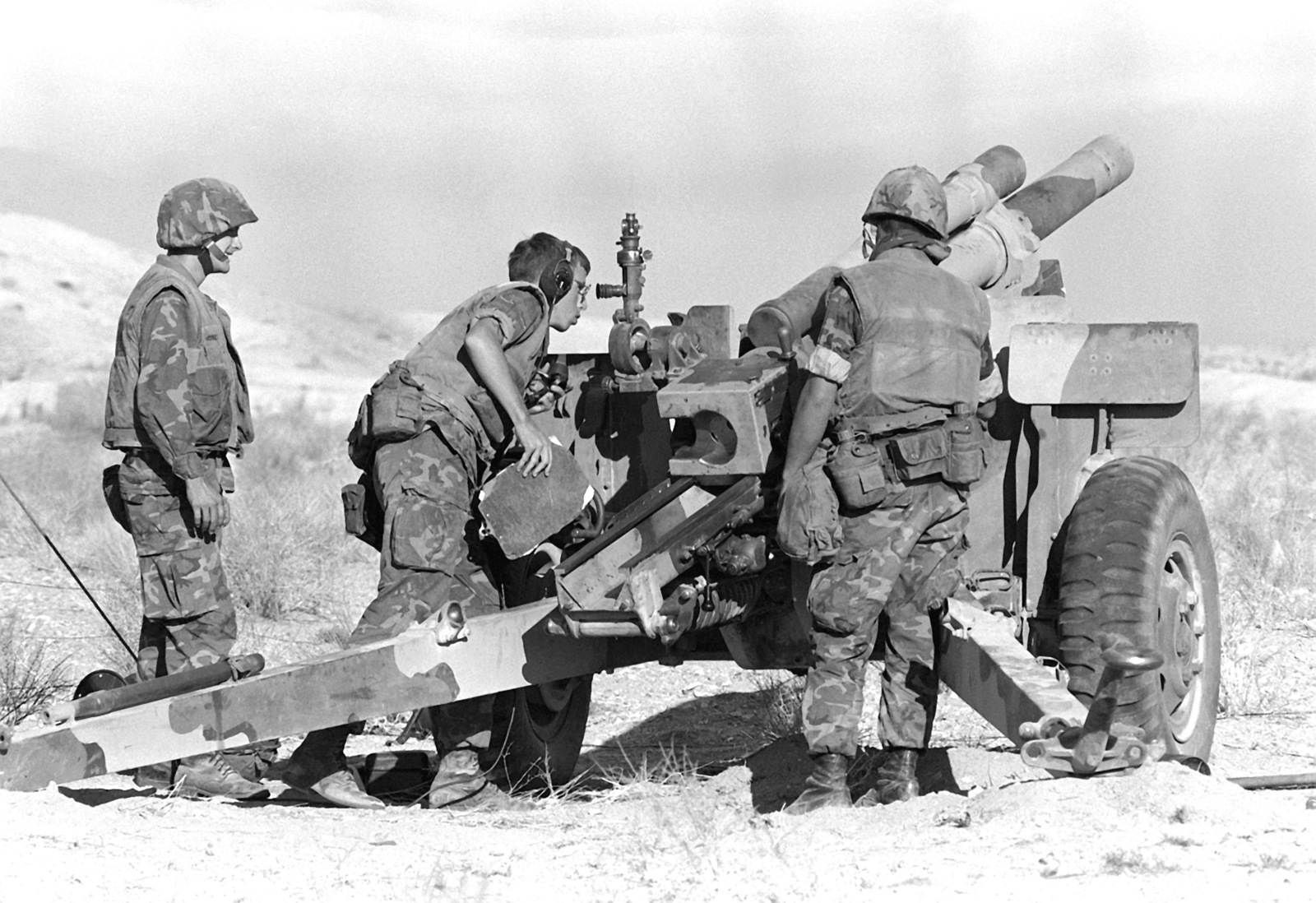 In preparation for setting up the 105mm howitzer, LCPL Hodges digs a fire pit for his gun team. These Marines are participating in Operation CAX-1-2-82