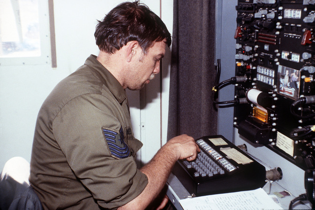 MSGT Charles Gardner operates an NA/VYA-7 digital data terminal during exercise Bright Star '82