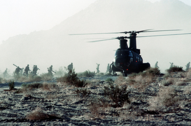 One of the Marine CH-46 Sea Knight helicopters taking part in a vertical envelopment (infantry landing) is unloaded. This is part of Operation CAX 1-2-82, held at the Marine Corps Air-To-Ground Combat Center