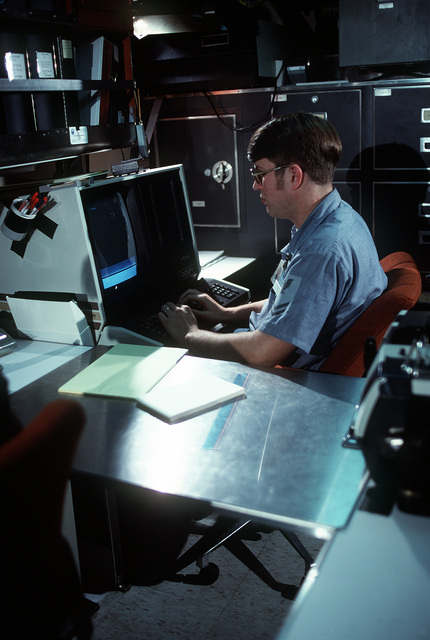 Personnelman 2nd Class (Submarines) Steven M. Krueger uses word processing equipment during precommissioning duty aboard the nuclear-powered ballistic submarine OHIO (SSBN-726). The submarine was built by General Dynamics Corp