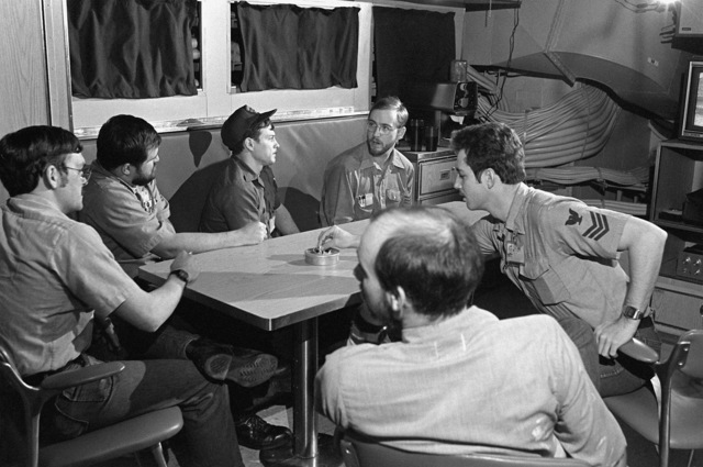 Six crewmen relax in a crew lounge aboard the nuclear-powered fleet ballistic missile submarine OHIO (SSBN-726). The OHIO, which was built by General Dynamics Corp., will be commissioned on Nov. 11, 1981