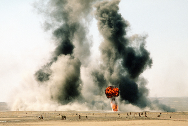 Smoke and flames billow up from a bomb dropped during exercise Bright Star '82
