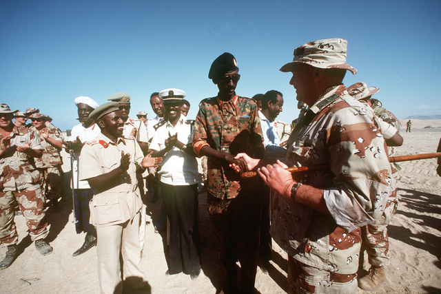 Somalian BGEN Mohammad Hashi Gani shakes hands with LGEN Robert C. Kingston (right), commander of the Rapid Deployment Joint Task Force, to greet him as he arrives to participate in exercise Bright Star '82