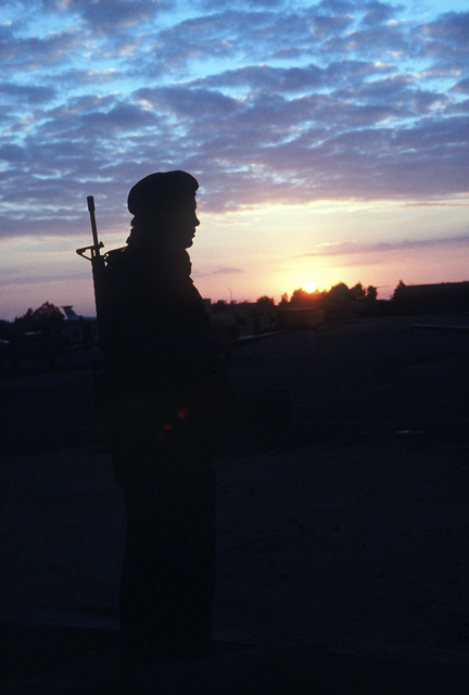 SSGT David Testerman, 354th Security Police Squadron, pauses as he stands guard duty in the early morning. The sergeant is taking part in exercise Bright Star '82