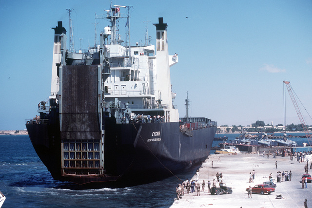 Starboard quarter view of the commercial roll-on/roll-off container ship CYGNUS (T-AK-113) preparing to dock during exercise Bright Star '82. The ship is carrying heavy equipment that is necessary for the exercise