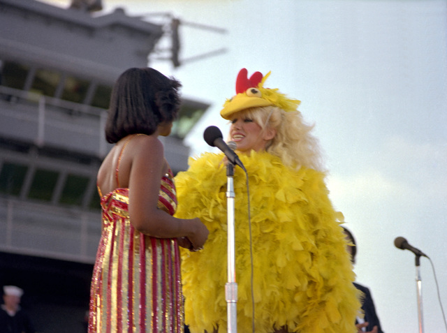 Suzanne Somers, wearing a big bird costume, talks to Gladys Knight during the special Suzanne Somers show aboard the aircraft carrier USS RANGER (CV-61)