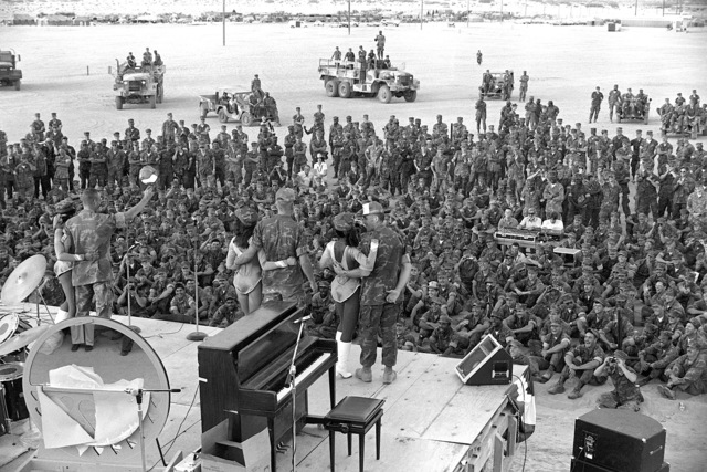 The 2nd Marine Division personnel take time out from their training in Operation CAX-1-2-82 and watch a show put on by the USO