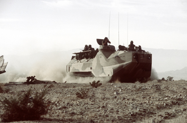 This LVTP-7 tracked landing vehicle is the command post for the Bravo command group and is traveling at a moderate speed during Operation CAX 1-2-82 at the Marine Corps Air-to-Ground Combat Center