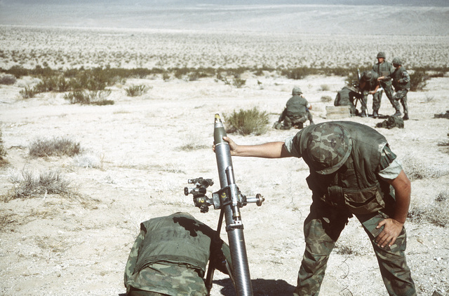 Two 81mm mortar sections from Weapons Co., 3rd Bn., 2nd Marines, prepare to fire during Operation CAX 1-2-82, held at the Marine Corps Air-to-Ground Combat Center