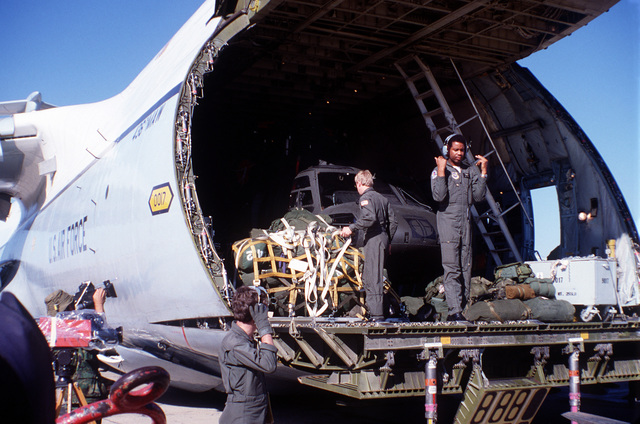 U.S. troops unload supplies from a C-5 Galaxy aircraft during exercise Bright Star '82