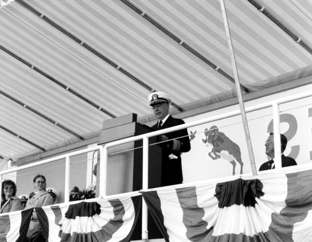 VADM Earl B. Fowler Jr., commander, Naval Sea Systems Command, speaks at the launching of the guided missile patrol combatant (hydrofoil) ARIES (PHM-5). To Fowler's right is Boeing Marine Systems Vice President Robert E. Bateman, whose company built the ARIES